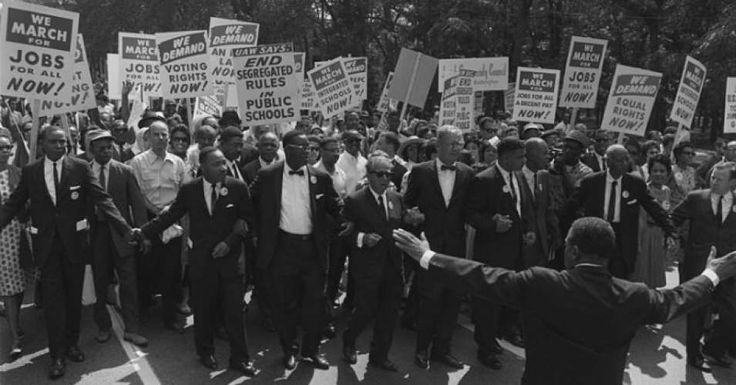 Civil rights and union leaders, including Martin Luther King Jr., Joseph L. Rauh Jr., Whitney Young, Roy Wilkins, A. Philip Randolph, Walter Reuther, and Sam Weinblatt, take part in the March on Washington for Jobs and Freedom on August 28, 1963.