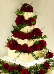 wedding cake chocolate red roses - Google Search Round, fewer roses, sea thistles, white stephanotis or other