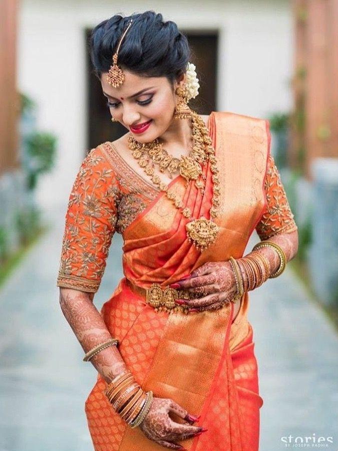 Salmon Colored Kanjivaram Silk Saree with Gold Temple Jewelry