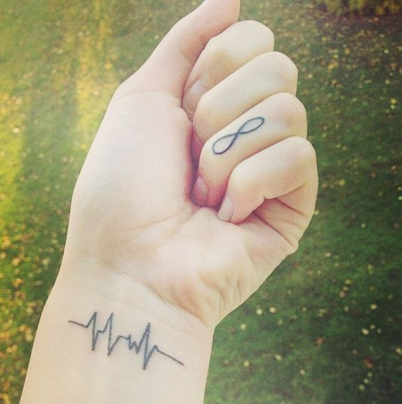 I have been seeing these more and more lately, and they're great -- especially for moms. Getting tattoos of the heartbeats of each of my children is something I've considered. It's not clear whether this one is the wearer's own or someone else's, but it's a very cool idea that packs a huge emotional punch.