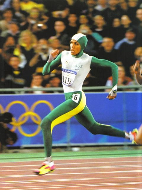 Cathy Freeman, carrying the entire population of Australia on her shoulders, wins gold at the 2000 Sydney games.
