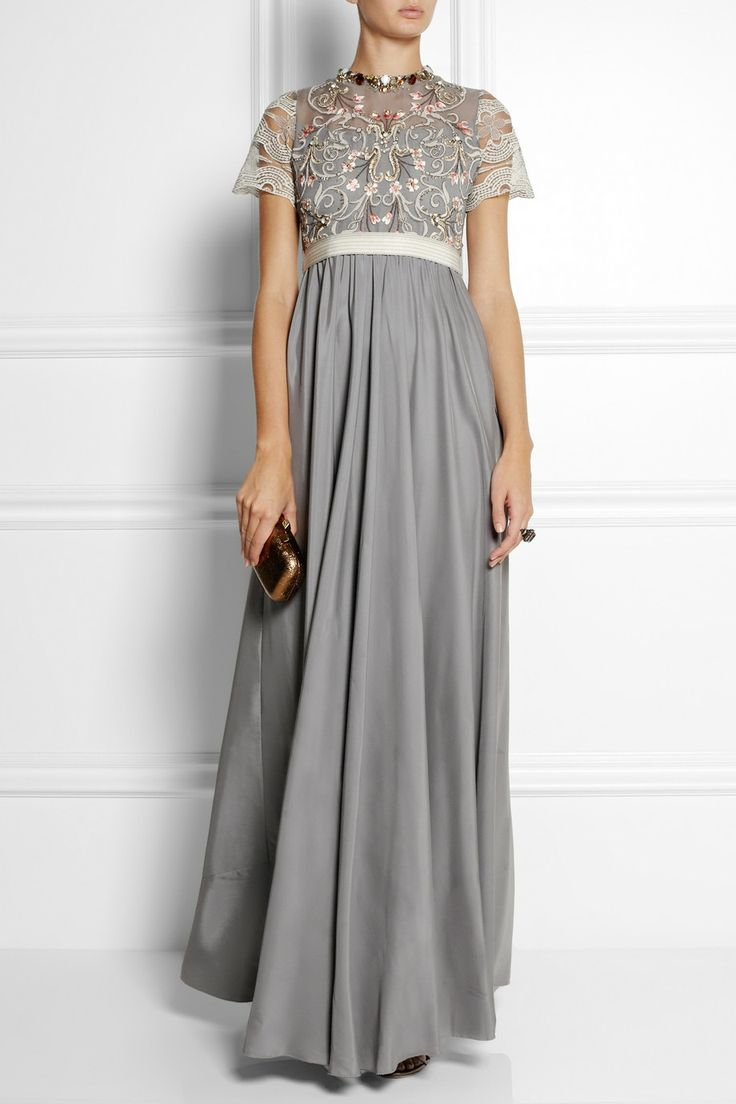 BIYAN Isobel embellished tulle and satin gown $1,875  Biyan's satin-skirted gown is inspired by Art Nouveau motifs. The tulle body has been hand-embroidered with pretty florals and the crystal-embellished neckline negates the need for a necklace. Cinch your waist with the optional grosgrain tie.