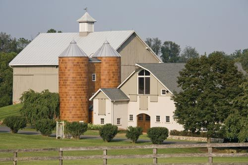Lovely Barn with twin terra-cotta silos.