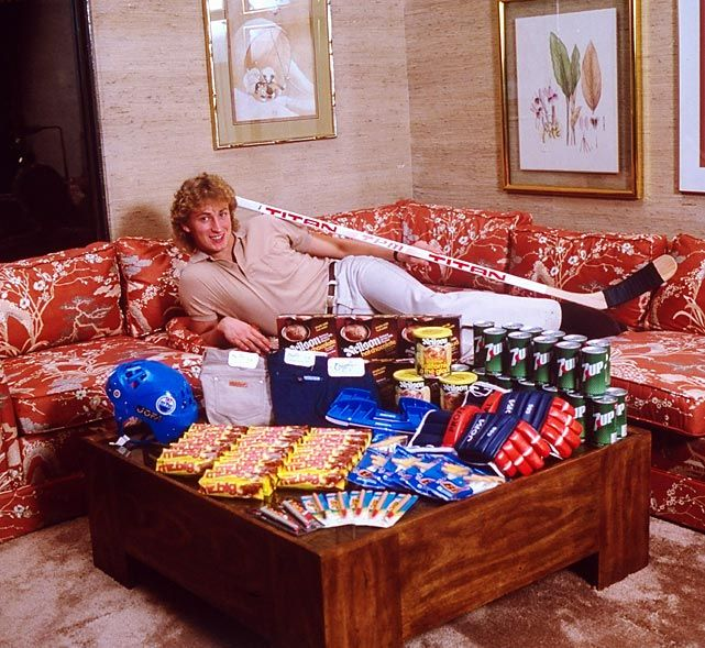 Wayne Gretzky poses with the spoils of his success, 1981.