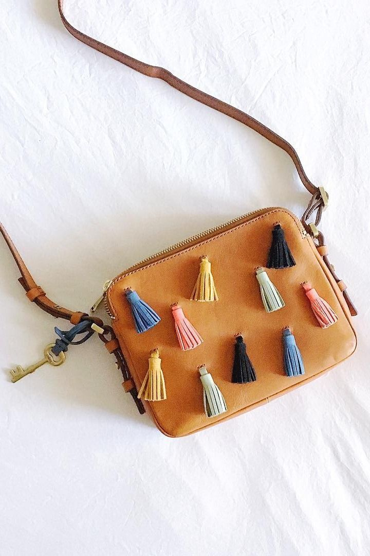 The classic Piper toaster crossbody complete with multi-color leather tassels. via @ theuncommonplace