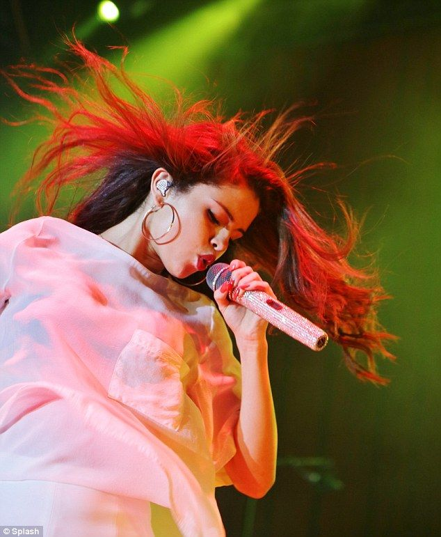 Cooing: The mega superstar princess Selena Gomez  let her mane fly out wildly onstage