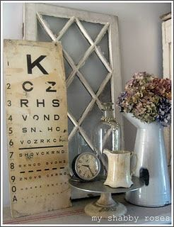 Vintage Shabby...old white multi-paned window...aged eye chart, tick tock, glass bottle, & pitcher.