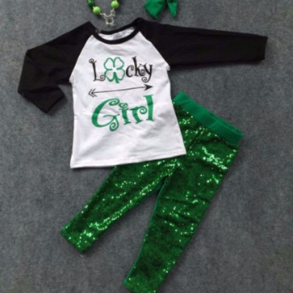 """ONLY 2 SIZES LEFT!! LOWEST PRICE EVER!! Get it for next year. """"Lucky Girl"""" with a four leaf clover is written on the long sleeve top and the leggings are green sequin! Top and bottoms included. Get it"""