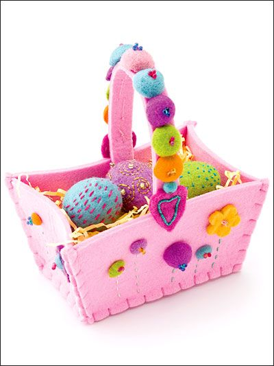 """Pop a few felt eggs into this clever felt basket with its own spring garden to make your little bunny happy!Finished size: 7"""" x 9"""" (including handle) x 3 1/2"""".Skill Level: Easy"""