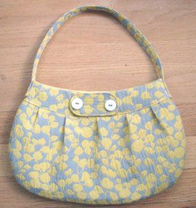 With this free purse pattern, sew your own buttercup bag. This purse is stylish and the perfect size for a day of shopping.
