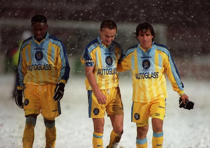 Celestine Babayaro, Dennis Wise and Gianfranco Zola walk off the snowbound pitch after their tie at Tromso, 1997.