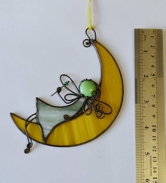 SIZE: 5.5 x 4 inches (14 x 10 cm) Beautiful suncatcher Fairy on the moon, real stained glass (not plastic) made with Tiffany Glass, and ready to hang. Item will be sent to you within 1 business day after payment is received via airmail. It usually takes about 10- 20 days to arrive. Friends, if you want to ask me question, please do not hesitate to contact me, even if you do not plan to buy it. I am happy to answer all your questions!!! :) To find more interesting glass please check out my…