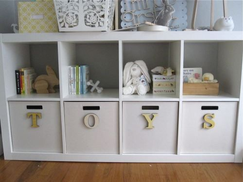 ikea expedit bookcase, target canvas bins, chip board letters with paper mod podged over - so cuuuute!