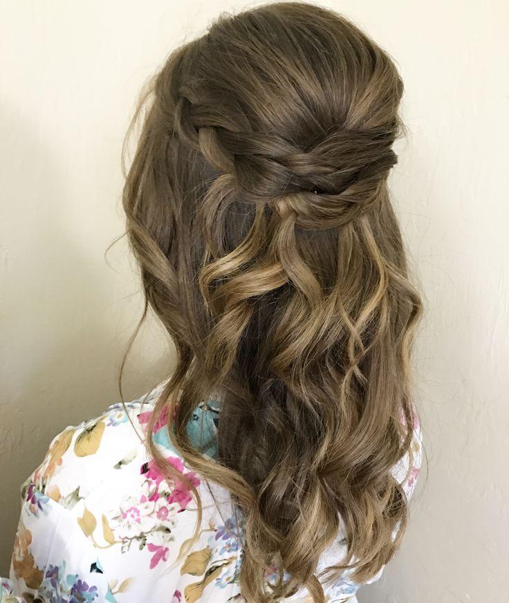 Bridal or bridesmaids hairstyle half up half down loose curls braided updo