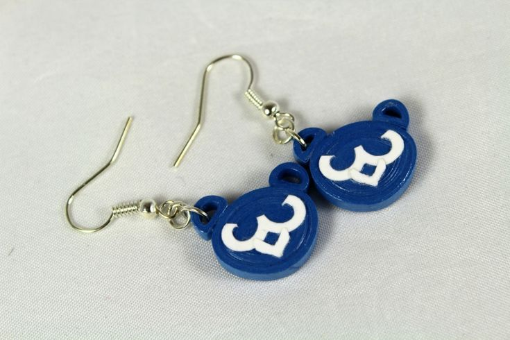 Handmade in Chicago, these dangle bear cubs earrings were crafted using blue quilling paper and treated with an eco-friendly water resistant sealant.