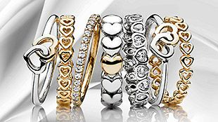 Make a romantic ring stack with heart-shaped rings in gold and silver. #PANDORA #PANDORAring