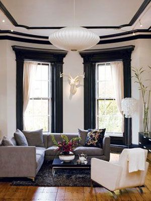 Instead of automatically going for white, try using black paint on your mouldings