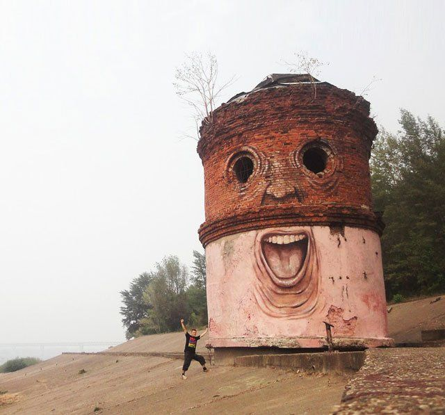 Russian artist Nikita Nomerz brings life to decrepit buildings in Russia by painting faces on them.