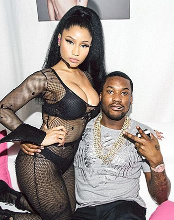 "Nicki Minaj and her rumored new boyfriend Meek Mill got cuddly backstage at her Paris concert on Wednesday, March 25. The ""Anaconda"" rapper, 32, showed off her voluptuous figure in a black mesh see-through jumpsuit with matching lingerie, while sporting a sleek high-ponytail."