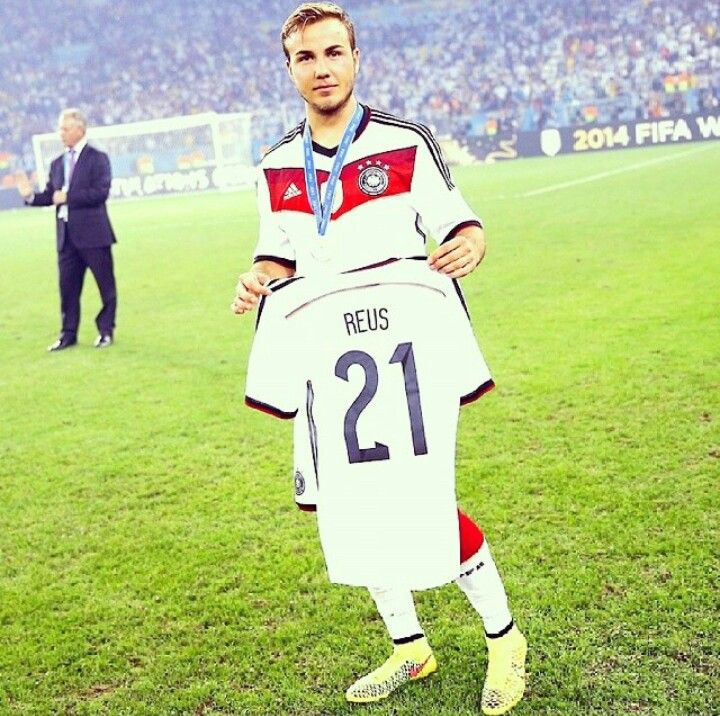 Winning goal maker, Mario Gotze holds up jersey of his best friend, injured midfielder Marco Reus who was unable to attend the cup 2014