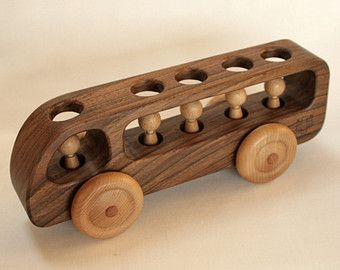 Dear customers,  Please note that our processing time for the wooden toys is now approximately 3 weeks. All orders made in December will be delivered in January.    This wooden bus was handcrafted from solid reclaimed chestnut wood. It has a beautiful brushed finish, you can feel and see the texture of the wood. It is very pleasant to touch. There are 5 wooden figurines that can be easily removed and placed back in.    This wooden toy car will make a beautiful present and is indispensable in…