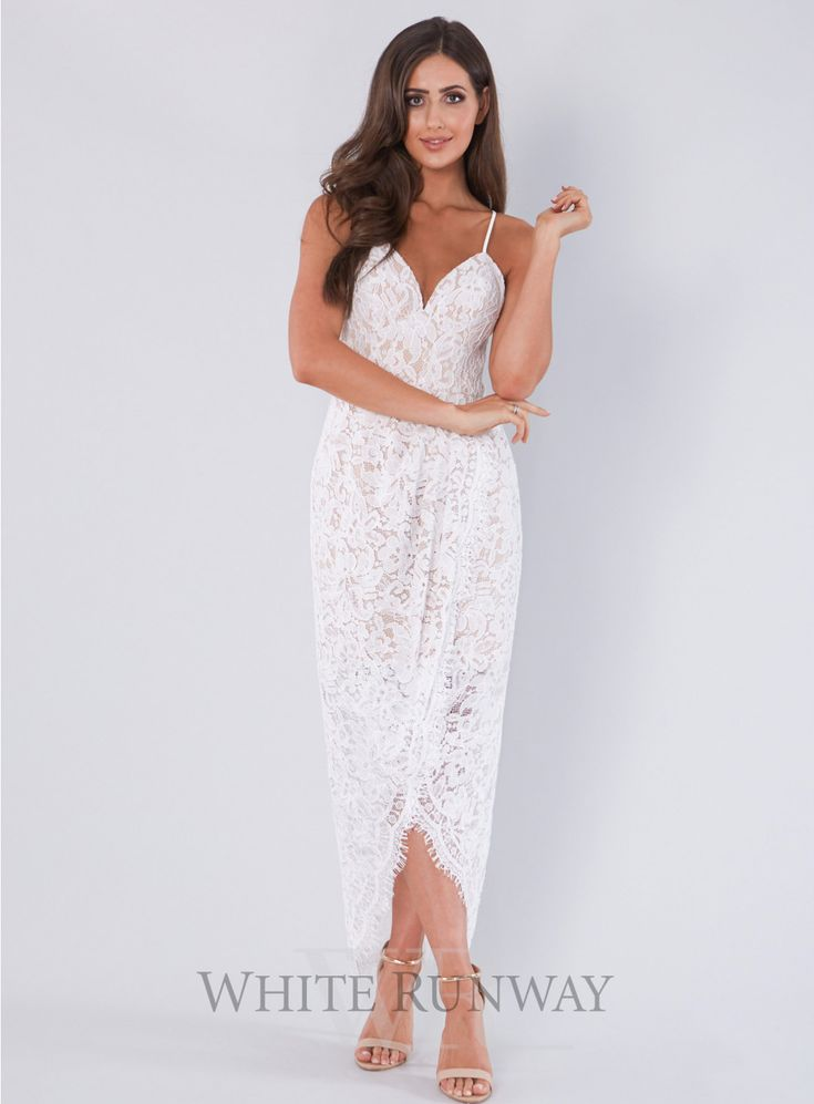 Lola Lace Dress. A gorgeous full length dress by Love Honor. A flattering lace style featuring a draped wrap skirt.