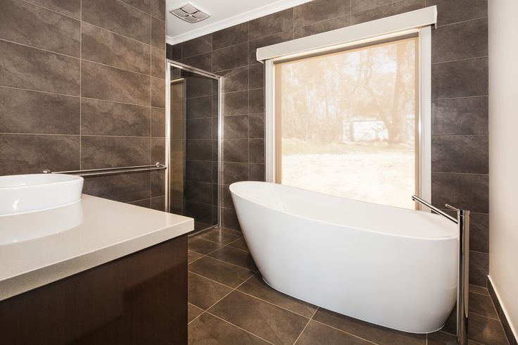 Floor to ceiling tiles, stand alone bath tub