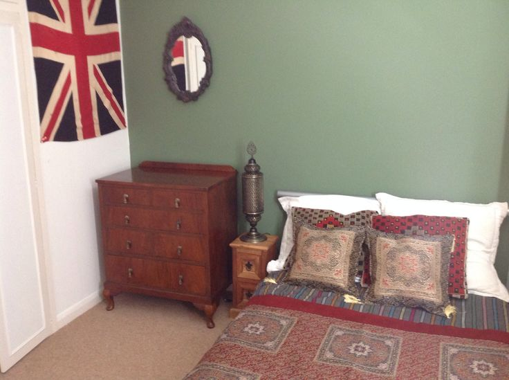 Sons wall painted in Farrow and Ball in chalke green with bedspread and light bought from Istanbul with antique flag