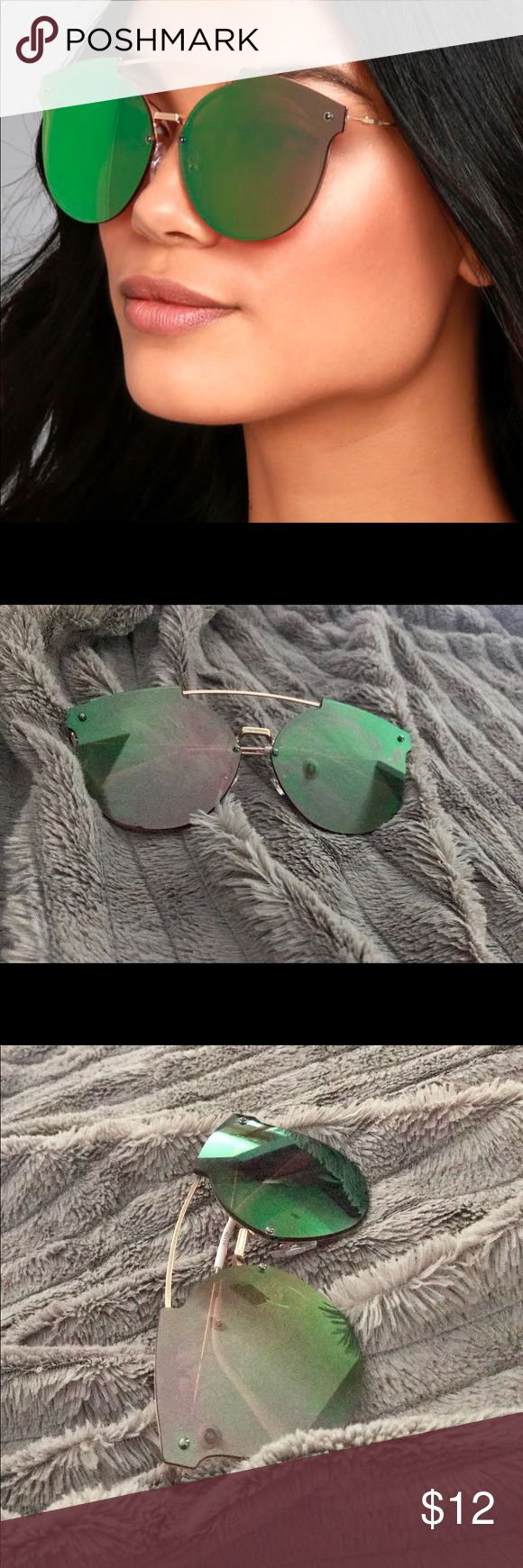 Gold  Mirrored Sunglasses Gold frameless pink mirrored sunglasses that flash green. Curved bridge. Accessories Sunglasses