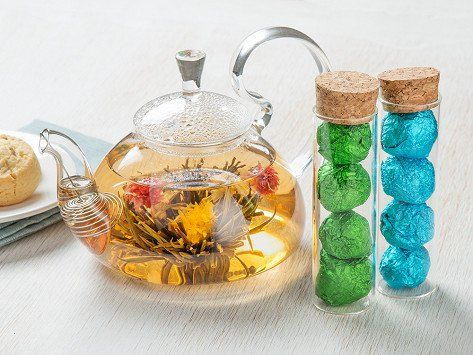 These blooming tea flowers turn tea time into a mesmerizing ritual. The blossoms open slowly inside the glass pot, and they're infused with Chinese tea that delivers delicious fragrance and flavor. Each flower is good for about three infusions. This set includes a beautiful glass teapot with a wire filter plus eight beautifully wrapped blooming teas.