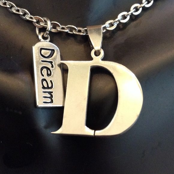 """Letter """"D"""" Pendant Both are almost 1 inch. Initial and 16 inch chain are stainless steel, dream charm is alloy. This item is the smaller of the two sizes I have. I'm sorry but I don't trade Jewelry Necklaces"""