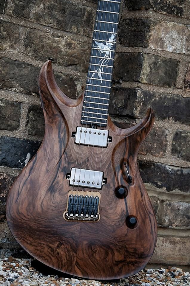Gorgeous guitar with dark wood whorls and lovely fretboard inlay. Sadly, the original pinners whoever they were deleted the source info...  - https://www.pinterest.com/DianaDeeOsborne/instruments-for-joy/ - INSTRUMENTS FOR JOY. For the sake of #Pinterest users who want more than pretty pictures: Please leave or copy into the description any info links. Only fair to give CREDIT, too. #DdO:) OHH- And feel free to add info in comments on my pins!