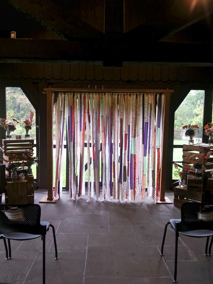 Such a fun back drop for a ceremony on the screen porch at happy days lodge