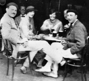 Ernest and Hadley Hemingway at a cafe with Lady Duff Twysden and others, Pamplona, Spain, 1925.