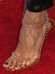 Noureen Dewulf wearing studded sandals.