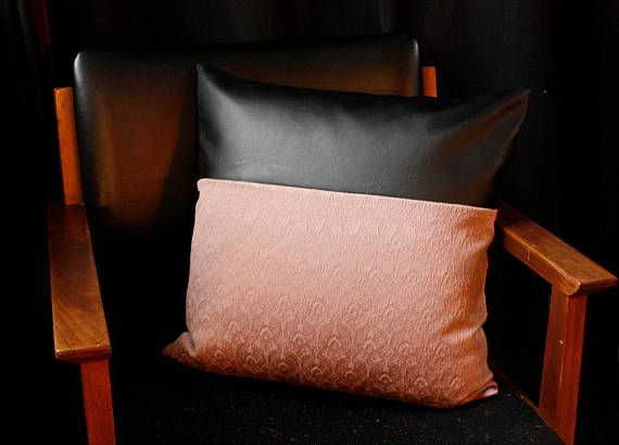 //product details// Faux leather pillow cover, with a panel of soft blush pink material. The back of the pillow is finished in a black backing, and the zipper closure is hidden. The pillow cover is 18x18. We recommending sizing up the pillow insert 1 or 2 sizes to really fill the