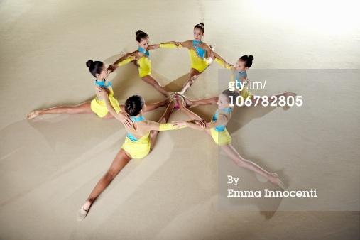 High-Res Stock Photography: gymnastic team circle split arm arounds