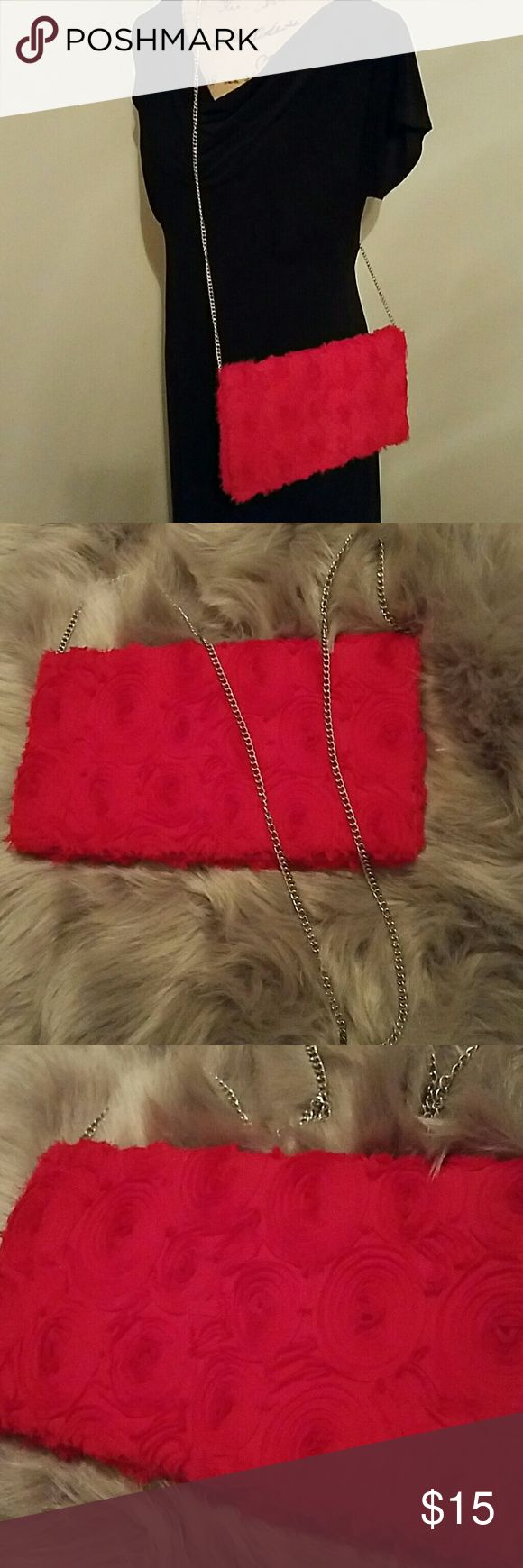 H&M purse ❤❤Priced to sell for Valentine's day! ❤❤Beautiful H&M red rosette crossbody or envelope clutch with attached chain strap. Perfect condition.  NWOT. H&M Bags
