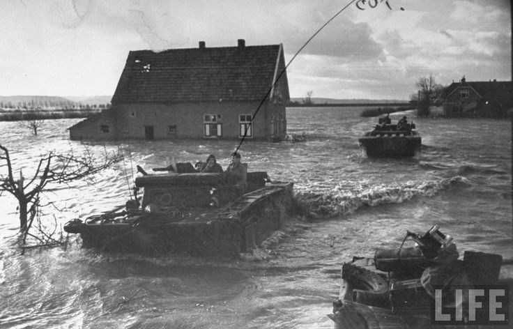 Canadian Amtraks pick up stranded soldiers on the Dutch island of Walcheren. The island, which is under sea level and was drained by Dutch diking centuries ago, was deliberately flooded by Allied bombing to isolate German troops to the high ground before a joint Anglo-Canadian invasion in October-November 1944.
