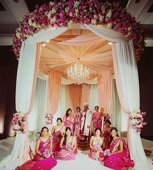 A very #romantic #mandap for #indianweddings from @prashe. #Love the #pink #roses, the draping, and the chandelier. #Repost