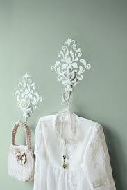 stencil a simple damask pattern and hang a hook- so pretty!