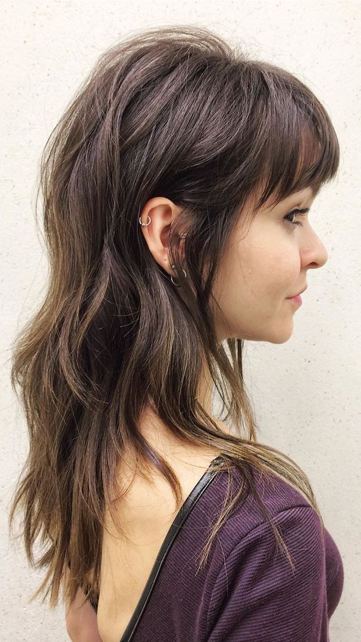Long layered wavy brunette shag haircut with wispy rounded bangs Like what yo