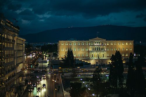 Athens by night during winter. Syntagma square with the Parliament House (former Palace of king Otto I) and Grande Bretagne Hotel at the left.