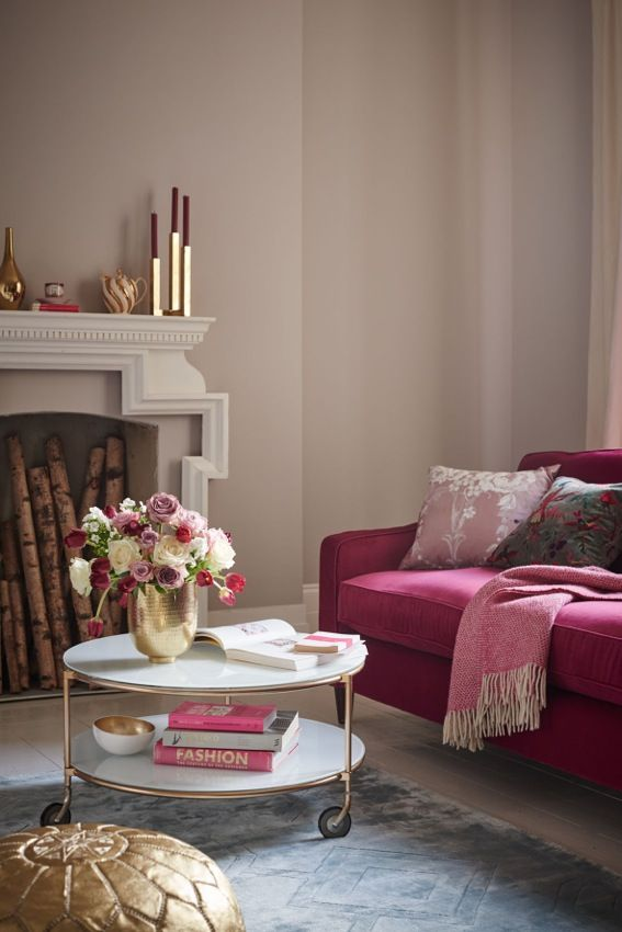 Living room decorating idea using Pantone's Pale Dogwood: Blush pink walls and a spot of white give this living room a cosy yet fresh appeal, leaving the cerise pink sofa to take centre stage. The white metal coffee table adds a contemporary feel and the gold accessories add a glittery zing. Pick patterned cushions for an extra bit of interest and texture. (Photo: Dulux). Find more tips at housebeautiful.co.uk
