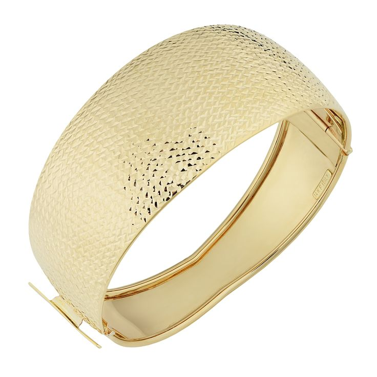 14k Yellow Gold Diamond-Cut And High Polish Wide Bangle Bracelet. Made in Italy. Beautifully crafted of 14k yellow gold. Features a diamond-cut and high polish finish. This 14k gold bangle secures with box with tongue closure. A bold, statement piece perfectly elegant for all occasions.