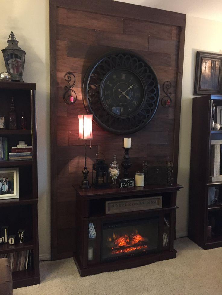 Nice backdrop behind your fake fireplace.   Fake fireplace ...