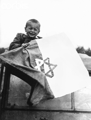 Liberation of Nazi Concentration Camp - 42-16719776 - Rights Managed - Stock Photo - Corbis. A little boy holds a handmade flag with the Star of David after the liberation of the Buchenwald concentration camp, Germany. Buchenwald was one of the largest concentration camps in Nazi Germany, established in July 1937, five miles north of Weimar.