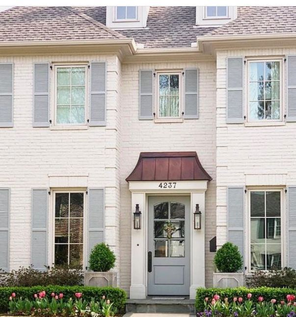 White Brick House With Light Blue Shutters In 2020 Painted Brick House White Brick Houses House Paint Exterior