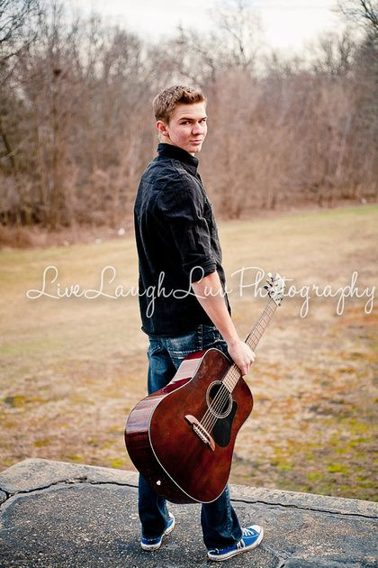 Senior Boy Session. ©LiveLaughLuv Photography www.livelaughluvphotography.com. Spring, old building, bricks, guitar, poses, high school senior.