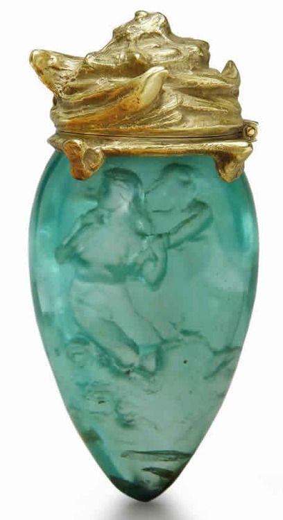 Sirens perfume bottle. Rene Lalique (1860-1945). Circa 1905. Glass, metal.